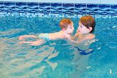 Two Children Playing In A Swimming Pool