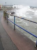 Wave Splashing Over Coastal Promenade