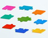 Parts Of Colorful Puzzles On A White Background. Set Of 9 Vector Pieces
