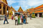 Temples and tourists at Bangkok's Grand Palace.