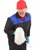 Man in workwear with mop.