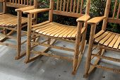 Trio of wooden Adirondack rocking chairs