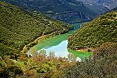 Green lake on mountains
