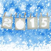 Snow-covered Paper Numbers Of New 2015 With Snow On Abstract Background