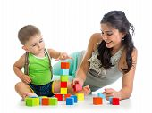 Little Boy And Mother Playing Together With Construction Set Toy