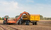 foto of tractor-trailer  - Picking machine mounted on the tractor and a farm trailer  - JPG
