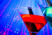 Red Cocktail With Blue Light Disco Background With Space For Text