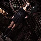 Weird Young Girl Holding Black Balloon