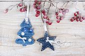 Christmas Trees And Stars On A Branch With Berries