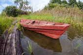 Summer's Lake Scenery With Old Wooden Boat