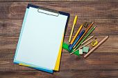 stationery objects on wooden background