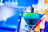 Blue And Red Cocktail With Lounge Bar Background With Space For Text