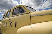 Vintage Taxi Cab In Pale Yellow