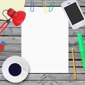 Lie on wooden floor smartphone and empty paper sheet