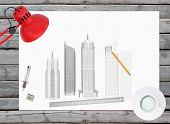 Architectural drawing and office supplies on the background of wooden boards