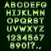 Vector golden and green neon alphabet  on dark background