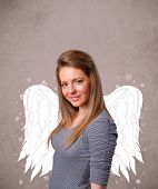 Young girl with angel illustrated wings on grungy background