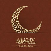 Arabic Islamic calligraphy of text Eid-Ul-Adha and golden moon on brown background for Muslim community festival celebrations.
