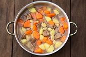 stock photo of hungarian  - Pot filled with traditional Hungarian soup called Gulyasleves made of beef potato carrot onion csipetke  - JPG