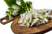 Fresh, Organic Slices Of  Fennel On A Wooden Board