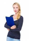 Caucasian woman with clipboard
