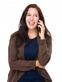 Brunette woman talk to mobile phone