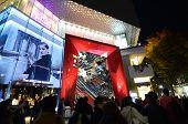 Tokyo, Japan - November 24, 2013: People Shopping Around Retail Shops On Omotesando Street At Night