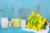 Yellow and green flowers  on color wooden background
