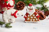 Gingerbread Santa Claus and polar bear with Christmas decor