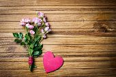 Pink garden roses and a heart on wooden board, Valentines Day background, wedding day. Love.