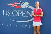 US Open 2014 girls junior champion Marie Bouzkova from Czech Republic during trophy presentation
