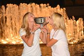 US Open 2014 women doubles champions Ekaterina Makarova and Elena Vesnina posing with US Open trophy