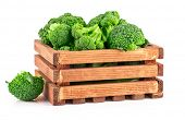 Cabbage broccoli in wooden box. Isolated on white background