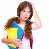 Portrait of confused school girl holding head by hand isolated on white background, didn't know answ