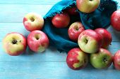 Juicy apples on wooden table, close-up