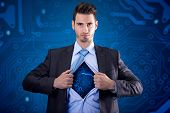 businessman as super hero with electrical circuit under the shirt