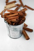 Cinnamon bark in pail on wooden table