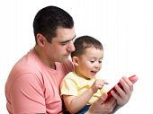 Man And Son Kid Playing With Tablet Computer