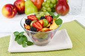 fresh tasty fruit salad on table