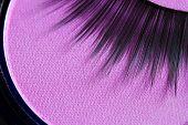 Eyelashes and eye shadow cosmetics abstract background