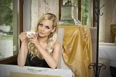 Girl With Cup Of Tea In Vintage Cafe