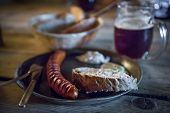 Fried sausages with bread and beer