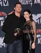 LOS ANGELES - APR 13:  Channing Tatum & Jenna Dewan-Tatum in the 2014 MTV Movie Awards - Press Room  on April 13, 2014 in Los Angeles, CA.