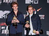 LOS ANGELES - APR 13:  Josh Hutcherson & Sam Claflin in the 2014 MTV Movie Awards - Press Room  on April 13, 2014 in Los Angeles, CA.