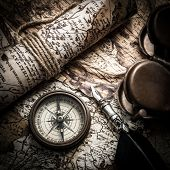vintage  still life with compass,sextant and old map..map used for background is in Public domain. M