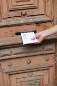 pic of postbox  - Letter in hand near postbox - JPG