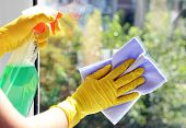 foto of window washing  - Cleaning windows with special rag and cleaner - JPG
