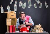 Happy businessman is laundering money