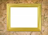 Blank Golden Frame On Cement Wall