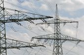 picture of utility pole  - group of many electric pylons with high voltage - JPG